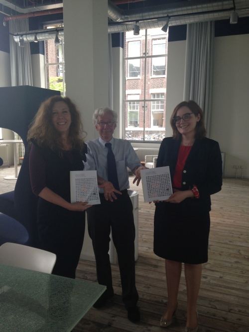 Proud of the results so far, and thanking EUA for their support from the start by giving the first copy to EUA's Enora Pruvot (in the background: chairman Hans Beunderman, former dean and vice rector TU Delft)